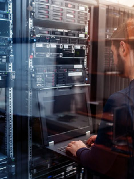 https://www.ikontechdevelopment.us/wp-content/uploads/2021/09/94030662-young-it-engeneer-business-man-with-thin-modern-aluminium-laptop-in-network-server-room-1-470x630.jpg